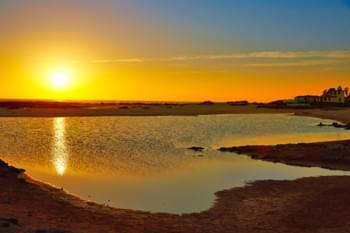 Puesta de sol en la playa de La Concha en Fuerteventura